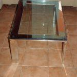 Mesa centro asimerica de acero inoxidable y cristal. Decor